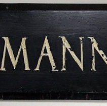 "Image of Metal wall sign: R. Neumann & Co. 9"" high x 36"" long x 3/4"" thick. Black painted metal with white lettering. No date, ca. 1920-30. - Sign"