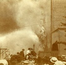 Image of Sepia-tone photo of the warehouse on fire during the Hoboken pier fire, ca. June 30, 1900. - Print, Photographic