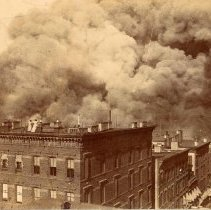 Image of Sepia-tone photo of 1900 pier fire taken from a roof top appearing to be on 2nd or 3rd Sts., Hoboken, no date, ca. June 30, 1900, later print, 1913. - Print, Photographic