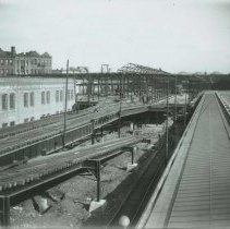 Image of B+W photo of Public Service, Hudson Place Terminal - looking east from temporary elevated loop, Hoboken, February 9, 1910. - Print, Photographic