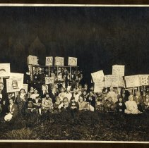 Image of Sepia-tone photo of students in costume for a lacrosse(?) team rally in Elysian Park, Hoboken, 1914. - Print, Photographic