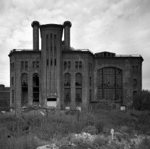 Image of B+W photo of the exterior of the Hudson and Manhattan Powerhouse in Jersey City, no date, ca. 1998. - Print, Photographic