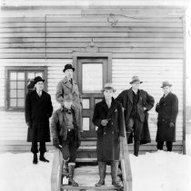 Image of Color copy photo of B+W photo of winter view of six men standing outside the Lawson & Macmurray Lumber Co. office, Hoboken, no date, ca. 1934-35. - Print, Photographic