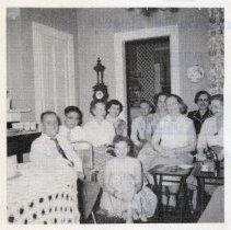 Image of detail photo left center: Club members inside 1217 Garden St.