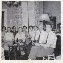 Image of detail photo left bottom: Club members inside 1217 Garden St.