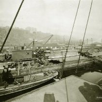 Image of Sepia-tone photo of a Union Dry Dock Repair Co. work pier in Weehawken, N.J., no date, ca. 1920. - Print, Photographic