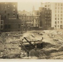 Image of Sepia-tone photo of foundation preparation on the site for the Fabian Theatre, southeast corner of Newark & Washington Sts., Hoboken, Dec. 3, 1927. - Print, Photographic