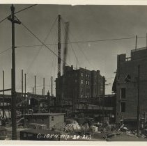 Image of Sepia-tone photo of steel frame erection on the site for the Fabian Theatre, southeast corner of Newark & Washington Sts., Hoboken, Feb.21, 1928. - Print, Photographic