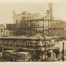 Image of Sepia-tone photo of steel frame erection & Newark St. frontage for the Fabian Theatre, Newark & Washington Sts., Hoboken, March 12, 1928. - Print, Photographic