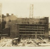 Image of Sepia-tone photo of steel frame erection & construction of the stage house for the Fabian Theatre, Hoboken, no date, ca. Feb.-March, 1928. - Print, Photographic