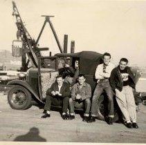 Image of B+W photo of 5 men posed in or on a car at a Hoboken pier head, Hoboken, 1953? - Print, Photographic