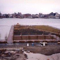 Image of Color photo of an elevated view of construction progress of Pier A Park, Hoboken, 1999. - Print, Photographic