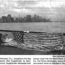 Image of B+W printed photo of the Georgia Children's Memorial Flag with as hung by Robert Guglielmetti at Pier A Park, Hoboken, ca. November, 2001. - Print, Photographic