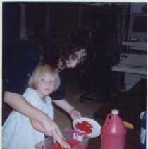Image of Color photo of Amy Young and female Glenwood Primary School student preparing paint for Georgia Children's Memorial Flag, Rome, Georgia, September, 20 - Print, Photographic