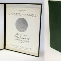 Image of certificate and presentation binder