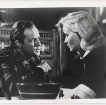 """Image of B+W publicity photo of Marlon Brando as Terry Malloy, Eva Marie Saint as Edie Doyle in film """"On the Waterfront,"""" Hoboken, no date, ca. 1953-1954. - Print, Photographic"""