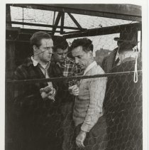 """Image of B+W publicity photo of Marlon Brando as Terry Malloy with director Elia Kazan on the set of film """"On the Waterfront,"""" Hoboken, no date, ca 1953-54. - Print, Photographic"""