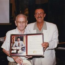 Image of Color photo of Mayor Anthony Russo handing Mayoral Proclamation to George Kirchgessner, Hoboken City Hall, June 27, 1997. - Print, Photographic