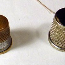 Image of Two sewing thimbles belonging to Dominic Pescatore of Hoboken, no date, ca. 1910-1920. - Thimble