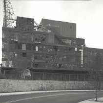 Image of Digital image of B+W photo of former Maxwell House Coffee plant exterior, looking south at north wall of Manufacturing Building, Hoboken, 2003. - Print, Photographic