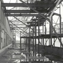 Image of Digital image of B+W photo of former Maxwell House Coffee plant exterior, east roof with sign framework of Manufacturing Building, Hoboken, 2003. - Print, Photographic