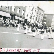 Image of Digital image of b+w photo of three fife players of St. Joseph's Fife, Drum & Bell Corp marching on street, Hoboken, 1949. - Print, Photographic