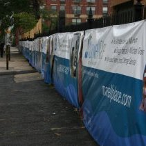 Image of Digital color image of the Maxwell House Coffee plant site with printed vinyl fence sign banners, Hoboken, October 2004. - Print, Photographic