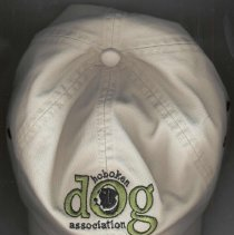 Image of Baseball-style cloth cap with embroidered logo of the Hoboken Dog Association, Hoboken, no date, ca. 2000-2004. - Hat