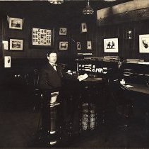 Image of Digital image of a sepia-tone photo of John Muller seated in his insurance office, Hoboken, no date, ca. 1920's. - Print, Photographic