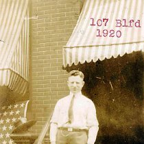 Image of Digital image of sepia-tone photo of John Muller standing on steps outside 107 Bloomfield St., Hoboken, 1920. - Print, Photographic