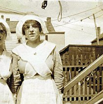 Image of Digital image of sepia-tone photo of Leonore Toepfer (Muller) in a volunteer uniform similar to 'candystripers', Hoboken(?), no date, ca. 1917. - Print, Photographic