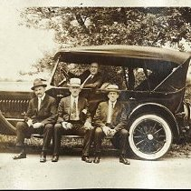 Image of Digital image of sepia-tone photo four men with an automobile, no place, no date, circa 1923. - Print, Photographic