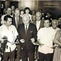 Image of Digital image of black-and-white photo of a ribbon cutting ceremony inside D & V Barber Shop, 1032 Washington St., Hoboken, 1966. - Print, Photographic