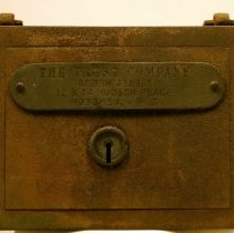 "Image of Steel bank with handle: from plate that reads ""The Trust Company of New Jersey, 12 & 14 Hudson Place, Hoboken, N.J.,"" Hoboken, no date, ca. 1910-1950. - Box, Safe Deposit"