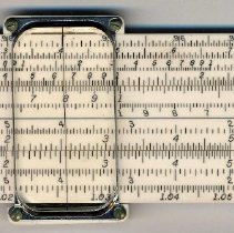 Image of Slide rule, Ivorite, 4181-1C, with holder manufactured by Keuffel & Esser Company, Hoboken, ca. 1953. - Rule, Slide