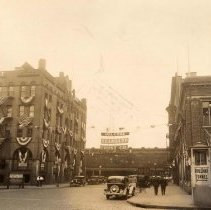 Image of Sepia-tone photo of signs and bunting celebrating the Seaboard Trust Company, Hoboken, 1933. - Print, Photographic
