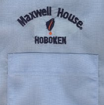 Image of detail embroidered logo over left breast pocket