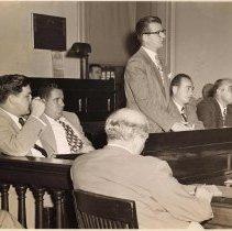 Image of Digital image of b+w photo of Mayor Fred M. DeSapio addressing Commissioners, City Hall, Hoboken, no date, ca. 1947-51. - Print, Photographic