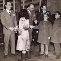 Image of Digital image of b+w photo of Mayor Fred DeSapio (at right) greeting children at City Hall, Hoboken, no date, ca. 1947-1950. - Print, Photographic