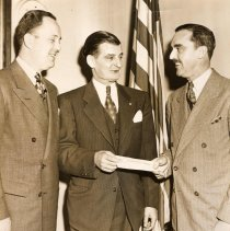 Image of Digital image of b+w photo of Mayor Fred DeSapio receiving check from Charles Regiban (sic - probably Kaegebehn), Hoboken, no date, ca. 1947-49. - Print, Photographic