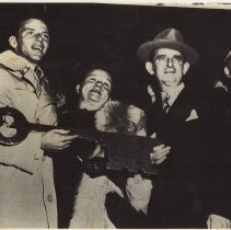 Image of B+W copy photo of Mayor Fred DeSapio presenting Frank Sinatra with Key to the City at Hoboken City Hall, Hoboken, Oct. 30, 1947. - Print, Photographic