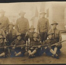 Image of Digital image of photo of a military unit posed with rifles outside a military barracks or other base building, no place, no date, circa 1900-1910. - Print, Photographic