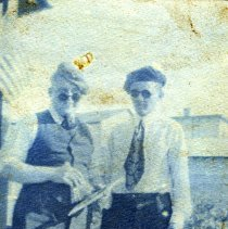 Image of Digital image of photo of two men wearing ties, caps and sunglasses on a porch, no place (probably not Hoboken), no date, circa late 1910-1920. - Print, Photographic