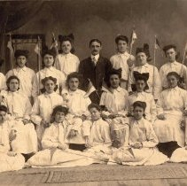 Image of Digital image of group photo of Our Lady of Grace School calisthenics class with instructor Julius Durstewitz, Hoboken, May, 1916. - Print, Photographic