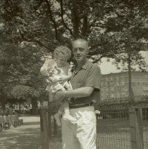 Image of Digital image of B+W negative image of Anthony Durstewitz? (Senior) in a park holding a baby, Hoboken. no date, circa 1938-1940. - Negative, Film