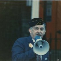 Image of Digital image of color photo of Tom Vezzetti with electric megaphone wearing American Legion Post 107 cap, Hoboken, no date, circa 1980-86. - Photograph