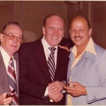 Image of Color photo of Mayor Steve Cappiello (center) with two men, Hoboken?, no date, ca. 1980-85. - Photograph