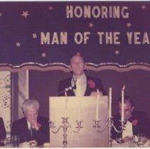 Image of Digital image of color photo of Mayor Steve Cappiello at podium for a dinner honoring a Man of the Year, Hoboken?, no date, ca. late 1970's. - Print, Photographic