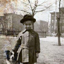 Image of Sepia-toned photo of a young boy 3 years old with dog taken in Elysian Park, Hoboken, no date, ca. 1920-1922. - Print, Photographic