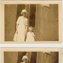 Image of Sepia-toned photo of a woman and child outside 108 Tenth St.Bloomfield St., Hoboken, no date, probably 1924-1926. - Print, Photographic